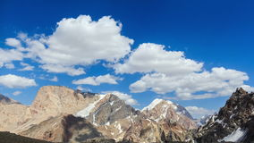 Snowy mountains in clouds. Time Lapse. Pamir, Taj stock footage