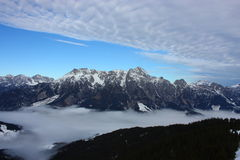Snowy mountains. And clouds in the valley Royalty Free Stock Photos