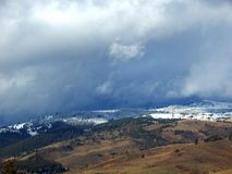 Snowy mountains with cloudy sky. Photographed in Romania Royalty Free Stock Photography