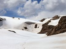 Snowy mountains with cornice Stock Photo
