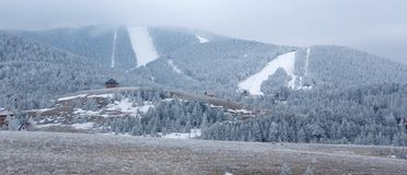 Snowy mountains with downhill ski slopes Stock Photos