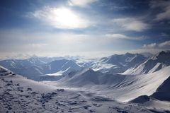 Snowy mountains in evening Royalty Free Stock Photography