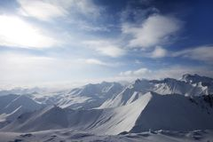 Snowy mountains in evening Stock Photography