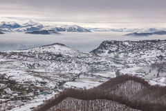 Snowy mountains with fog Stock Image