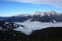 Snowy mountains. And a foggy valley Stock Photos