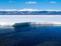 Snowy Mountains at frozen Lake Laberge, Canada Stock Images