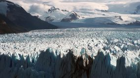 Snowy mountains glacier icebergs on background of clouds in Antarctica. Scenic peaks and ridges. Amazing nature. Travel and tourism in world of wildlife stock video