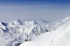 Snowy mountains in haze Royalty Free Stock Photography