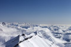 Snowy mountains in haze Stock Photos