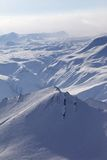 Snowy mountains in haze Royalty Free Stock Image