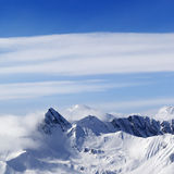Snowy mountains in haze Stock Photography