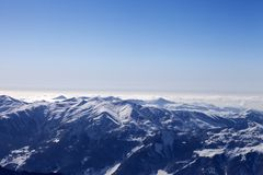 Snowy mountains in haze at morning Stock Image