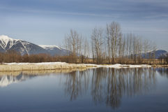Snowy mountains and lake Stock Photos