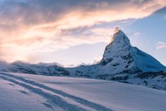 Snowy mountains landscape at sunset Royalty Free Stock Image