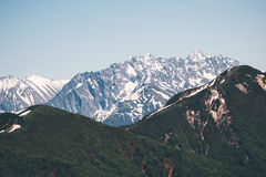 Snowy Mountains Landscape Travel serene scenic. Aerial view Royalty Free Stock Image