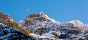 Snowy mountains and the moon Royalty Free Stock Images