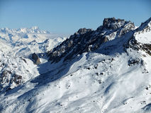 Snowy mountains. Mountain peak of the French Alps in Les Trois Vallees, France Stock Image
