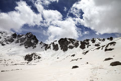 Snowy mountains at nice sun day Stock Images