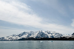 Snowy mountains and ocean Royalty Free Stock Images
