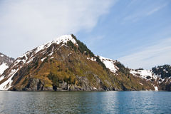Snowy mountains and ocean Stock Images