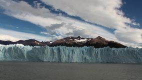 Snowy mountains panorama icebergs on background of clouds in Antarctica. Scenic peaks and ridges. Amazing nature. Travel and tourism in world of wildlife stock footage