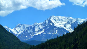 Snowy mountains. The photo shows the mountain peaks covered with snow Royalty Free Stock Image
