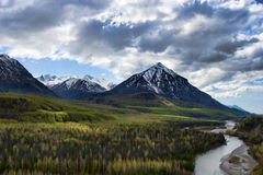 Snowy mountains and river landscape Stock Image