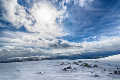 Snowy mountains Sayan. The view from the mountains in the Eastern Sayan mountains national Park Ergaki Royalty Free Stock Photography