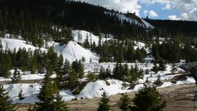 Snowy mountains in spring stock footage