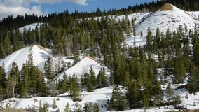 Snowy mountains in spring stock video footage