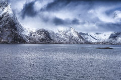 Snowy Mountains During Spring Time on Seashore Coastline in Norway Stock Photography