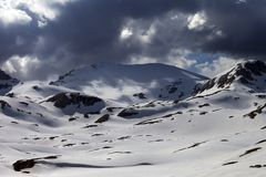 Snowy mountains before storm Stock Images