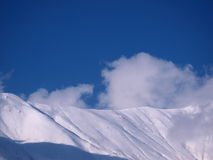Snowy mountains on a sunny day. Snow on the Italian Alps on a sunny winter day stock image