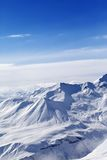 Snowy mountains in sunny day Royalty Free Stock Image