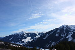 Snowy mountains. On a sunny day Stock Images