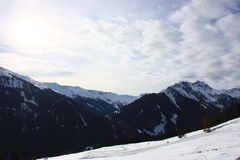 Snowy mountains. On a sunny day Stock Image
