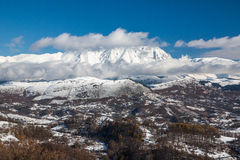 Snowy mountains in a sunny day Royalty Free Stock Photos
