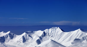 Snowy mountains at sunny day. Panoramic view Royalty Free Stock Photos