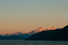 Snowy mountains at sunrise Stock Photography