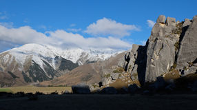 Snowy Mountains and Towering Limestone Formations. Stock Images