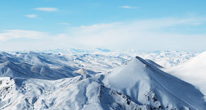 Snowy mountains under beautiful sky Royalty Free Stock Photo