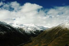 Snowy Mountains Under Blue Sky during Daytime stock images
