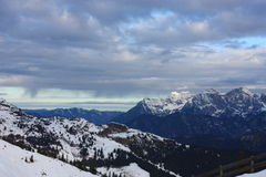 Snowy mountains. Under a cloudy sky Stock Images