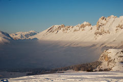 Snowy Mountains and Valley Coverd in Mist. A picture of a mountain landscape in the winter in Devoluy, France. The valleys were covered by clouds, but higher up Stock Image