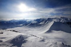 Snowy mountains and view on off-piste slope Stock Photography