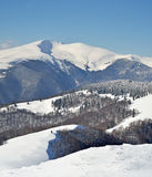 Snowy mountains view from precipice. Snowy mountains panorama view from precipice Stock Photography