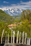 Snowy mountains and village Royalty Free Stock Image