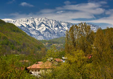 Snowy mountains and village Royalty Free Stock Photo