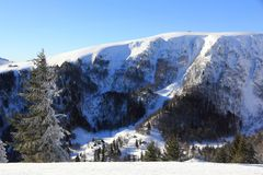 Snowy mountains of Vosges in France. The massif of Vosges and the Hohneck in winter royalty free stock image