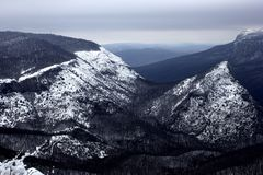 Snowy mountains in winter weather. Beautiful snowy winter in the mountains stock image